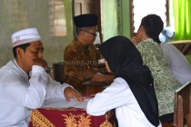 Para peserta saat mengikuti tes baca al-Qur'an sebagai salah satu rangkaian materi tes PSB di setiap unit